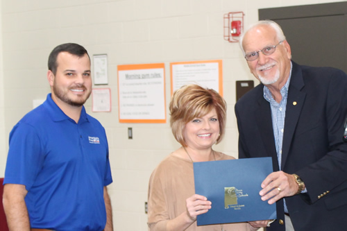Pam Richard, Maintenance Department, receiving a recognition from Mike Almaroad and Mr. Johnathon Shatus