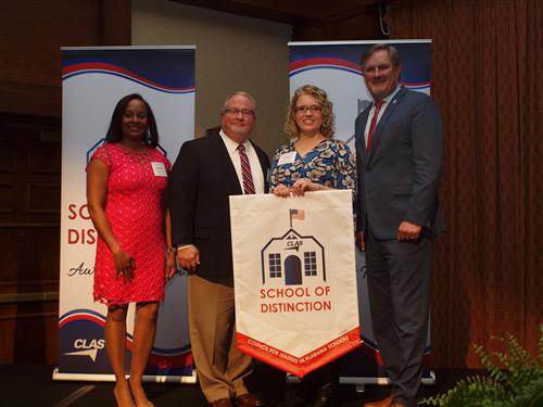 Superintendent Dr Jon Paul Campbell and Principal Summer Davis being honored as a CLAS School of Distinction
