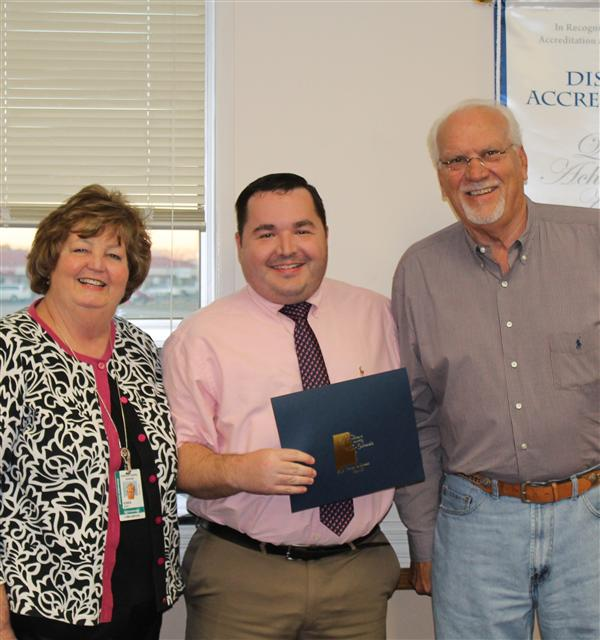 Technology Teacher of the Month Jason Clayton receiving certificate of recognition